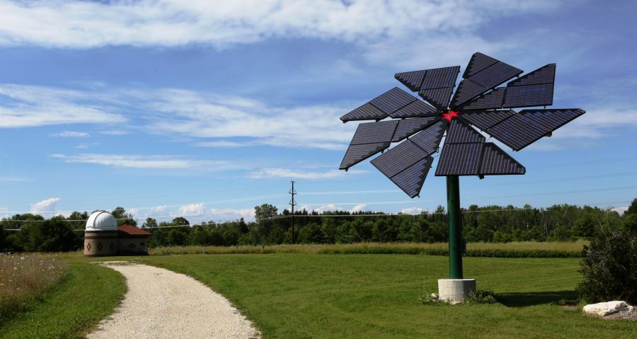 Solar panel array in the shape of a flower